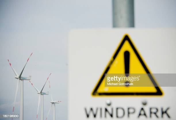 A sign with the inscription Windpark is seen in front of wind turbines near the coast of the north sea on August 29 2013 in Galmsbuell Germany Wind...