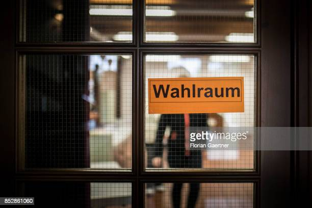 A sign with the lettering 'Wahlraum' is pictured on September 24 2017 in Diehsa Germany This Sunday 615 million people of Germany are called to give...