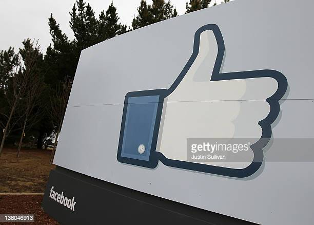 A sign with the 'like' symbol stands in front of the Facebook headquarters on February 1 2012 in Menlo Park California Facebook is expected to file...