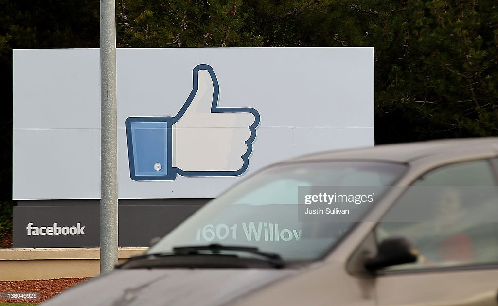 A sign with the 'like' symbol stands in front of the Facebook headquarters on February 1, 2012 in Menlo Park, California. Facebook is expected to file for its first initial public offering today seeking to raise at least $5 billion.