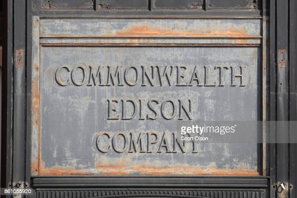 A sign with the name of Commonwealth Edison its former owner hangs above and entrance to the Crawford power plant which was taken offline in 2012 and...
