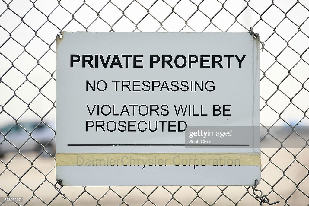 A sign with the old Daimler Chrysler Corporation name taped over is posted on the fence surrounding the Belvidere Assembly plant May 4 2009 in...