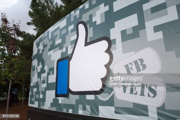 Sign with Thumbs Up logo for Facebook decorated for Veterans Day at the headquarters of social network company Facebook in Silicon Valley Menlo Park...
