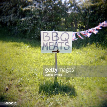 BBQ MEATS sign with Union Jack flags : Stock Photo