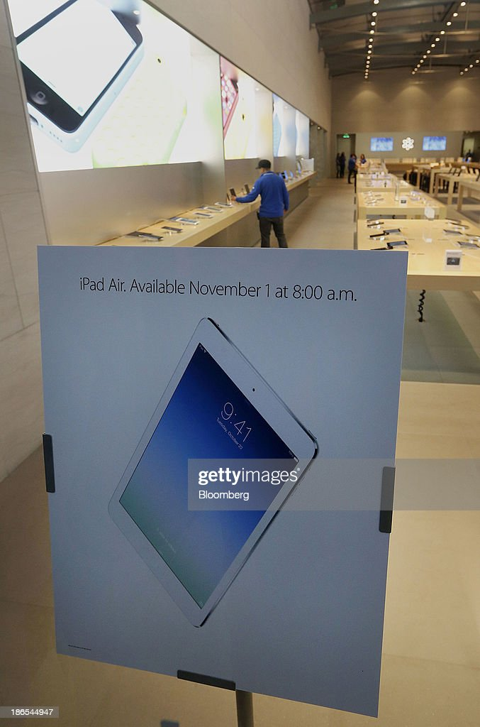 Signage advertising the sale of the new Apple Inc. iPad Air is displayed at a store in Palo Alto, California, U.S., on Friday, Nov. 1, 2013. Apple Inc.'s forecast for the slowest holiday sales growth in a half decade reflects how iPhones and iPads aren't providing the growth surges they once did as competition accelerates in the saturated mobile market. Photographer: Tony Avelar/Bloomberg via Getty Images
