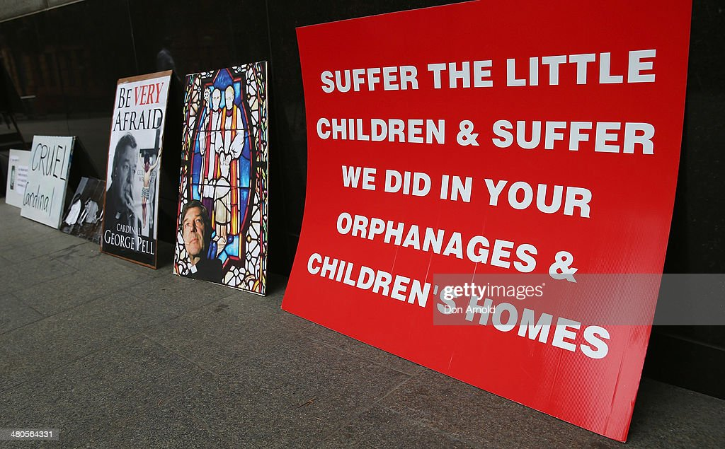 Signage and placards left by protesters can be seen outside Phillip Macquarie Tower on March 24, 2014 in Sydney, Australia. Cardinal Pell is facing the Royal Commission into Institutional Responses to Child Sexual Abuse in Sydney to answer questions about whether he was involved in compensation discussions related to the case of John Ellis who was sexually abused by Father Aidan Duggan.Cardinal Pell will soon move to Rome to undertake a senior role at the Vatican.