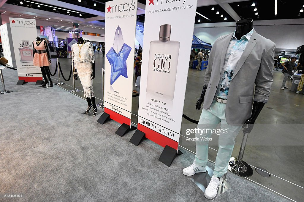 Signage and products from Macy's, Dior, Thierry Mugler, and Giorgio Armani are displayed at FAN FEST during the 2016 BET Experience on June 25, 2016 in Los Angeles, California.