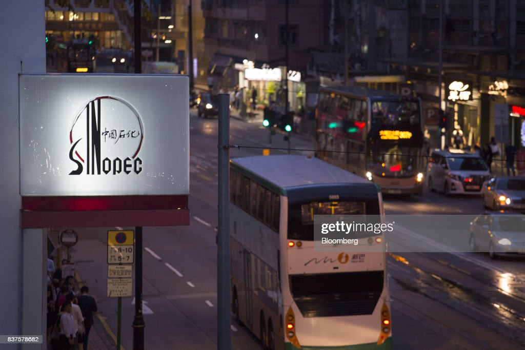 Signage for a China Petroleum & Chemical Corp. (Sinopec) gas station stands illuminated next to a road at dusk in Hong Kong, China, on Tuesday, Aug. 22, 2017. Sinopec is scheduled to report second-quarter results on Aug. 25. Photographer: Vivek Prakash/Bloomberg via Getty Images