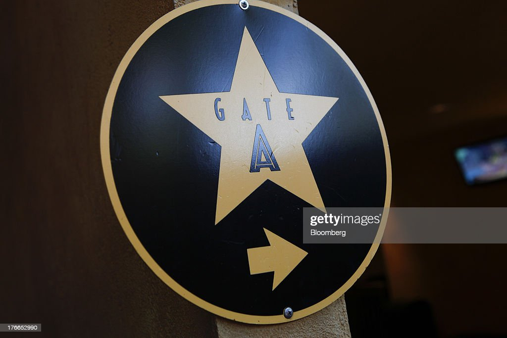 Signage for a 'Gate A' special pass entrance is displayed at the Universal Studios Hollywood theme park in Hollywood, California, U.S., on Thursday, Aug. 15, 2013. NBC Universal, majority owned by Comcast Corp., operates some of the most-watched U.S. cable TV channels, in addition to its flagship broadcast network, a film studio and the Universal Studios amusement parks. Photographer: Patrick T. Fallon/Bloomberg via Getty Images