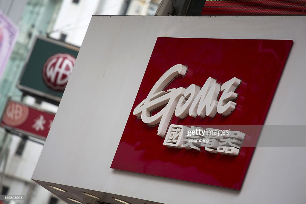 Signage for a Gome-branded store is displayed outside the store in the district of Tsuen Wan in Hong Kong, China, on Monday, Jan. 21, 2012. Gome Electrical Appliances Holding Ltd.'s stocks tumbled in Hong Kong after the company confirmed a report it is closing Gome-branded stores in the city. Photographer: Jerome Favre/Bloomberg via Getty Images