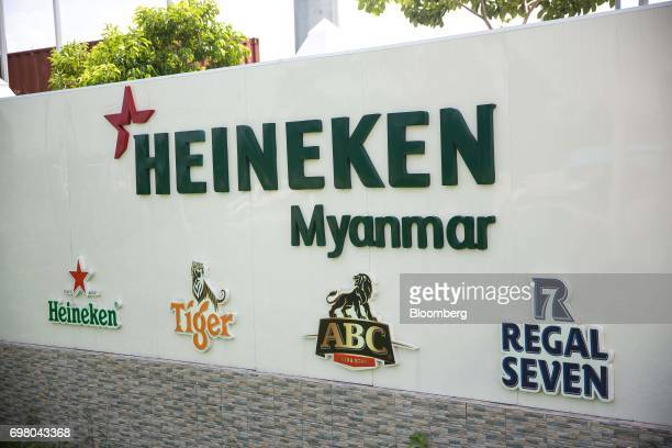 Signage for a Heineken NV stands outside the company's brewery in Yangon Myanmar on June 15 2017 Heineken is seeking to exploit the potential of the...