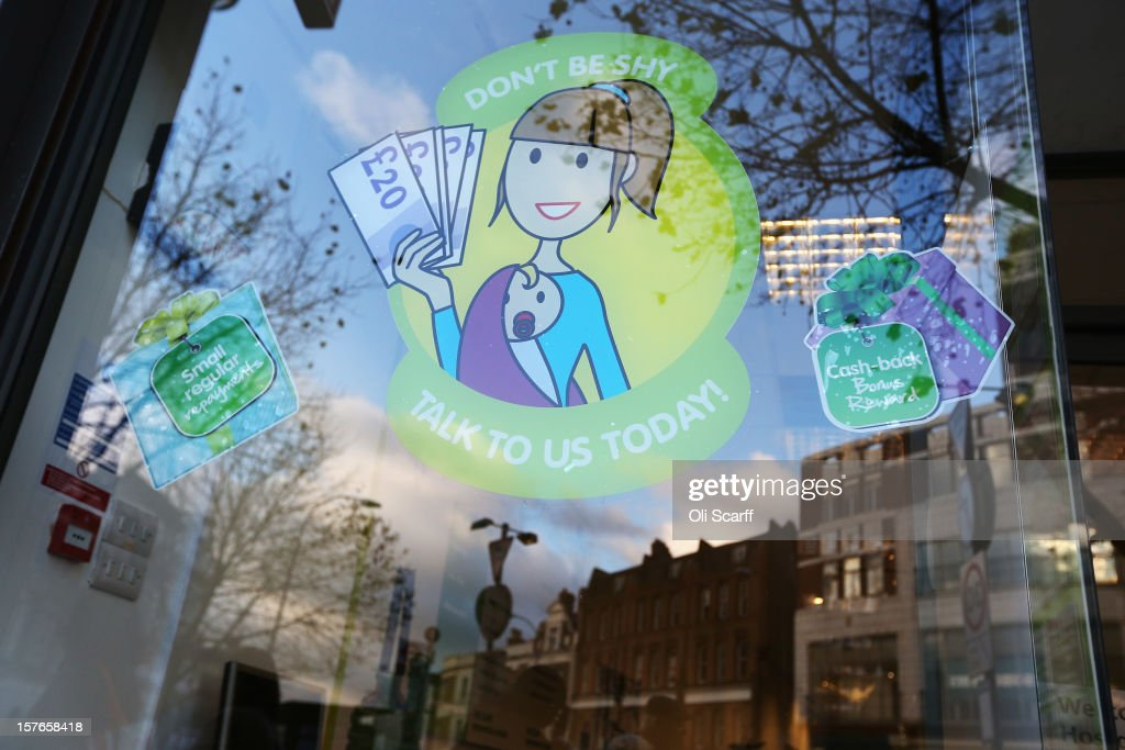 Signage for a money-lending shop on Lewisham high street on December 5, 2012 in London, England. The Chancellor of the Exchequer George Osborne has stated that the United Kingdom's economy is still struggling during his autumn budget statement to Parliament.
