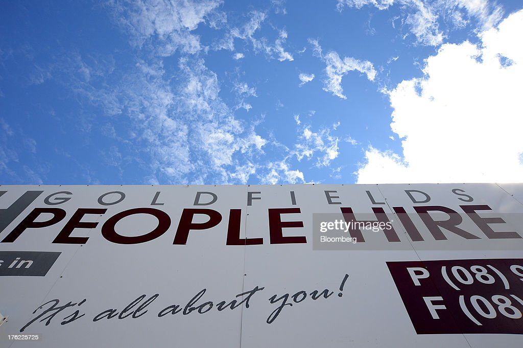 Signage for a recruitment office is displayed on a storefront in the mining town of Kalgoorlie, Australia, on Thursday, Aug. 8, 2013. Western Australia, the nation's largest state by area with 2.6 million square kilometers (1 million square miles) of land, earned A$97 billion from minerals and energy sales in 2012, down from A$108 billion in 2011, according to government figures. Photographer: Carla Gottgens/Bloomberg via Getty Images
