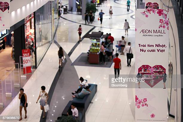 Signage for Aeon Co hangs at the retailer's mall in the Long Bien district of Hanoi Vietnam on Thursday July 21 2016 With a young population an...