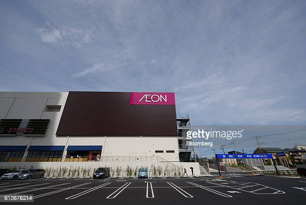 Signage for Aeon Co is displayed atop of an Aeon Town Co shopping mall in Sakura City Chiba prefecture Japan on Tuesday Oct 4 2016 Aeon Co Japan's...