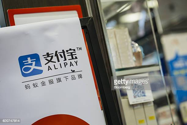 Signage for Ant Financial Services Group's Alipay an affiliate of Alibaba Group Holding Ltd is displayed outside a store in Hong Kong China on...