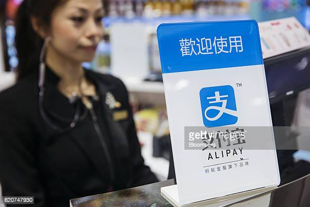 Signage for Ant Financial Services Group's Alipay an affiliate of Alibaba Group Holding Ltd is displayed at a cashier counter inside a Sa Sa...