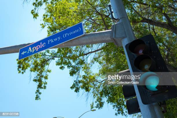 Signage for Apple Parkway with green traffic light one of the main roads entering the Apple Park known colloquially as 'The Spaceship' the new...