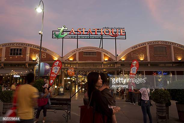 Signage for Asiatique The Riverfront openair mall is displayed at the market in Bangkok Thailand on Friday Dec 18 2015 Thai economic indicators have...