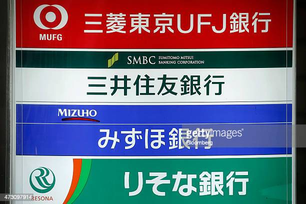 Signage for Bank of Tokyo Mitsubishi UFJ from top Sumitomo Mitsui Banking Corp Mizuho Bank Ltd and Resona Bank Ltd are displayed on a board outside a...