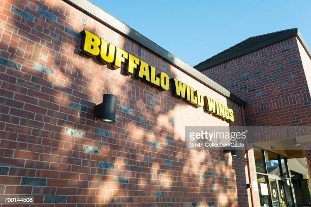Signage for Buffalo Wild Wings a popular sports bar and chicken wings restaurant in downtown San Ramon California June 15 2017