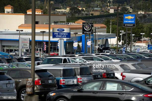Signage for car dealerships is seen in Colma California US on Friday March 29 2013 Domestic vehicle sales data is expected to be released April 2 US...
