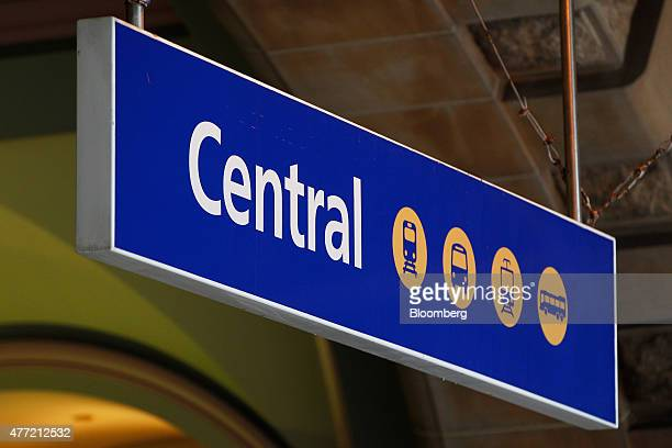 Signage for Central Station is displayed at the station in Sydney Australia on Tuesday June 9 2015 Australian wages fell in the first quarter for the...