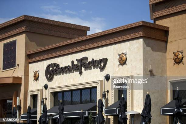 Signage for Cheesecake Factory Inc is displayed outside of a restaurant in the Canoga Park neighborhood of Los Angeles California US on Tuesday Aug 1...
