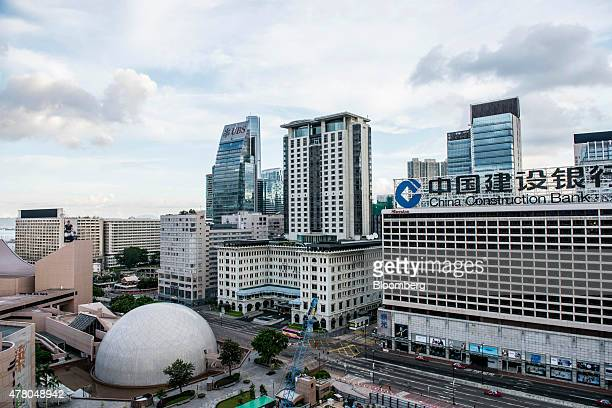 Signage for China Construction Bank Corp is displayed atop the Sheraton hotel operated by Starwood Hotels Resorts Worldwide Inc right as the...