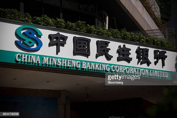 Signage for China Minsheng Banking Corp is displayed outside a branch in the Tianhe district of Guangzhou Guangdong province China on Monday Nov 25...
