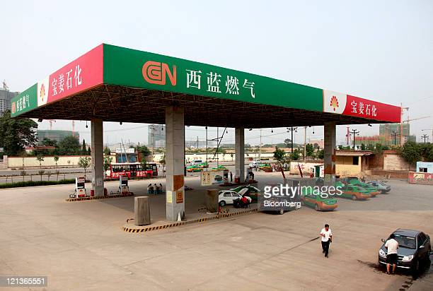 Signage for China Natural Gas Inc hangs at a filling station in Xi'an Shaanxi Province China on Thursday Aug 11 2011 China Natural Gas Inc...