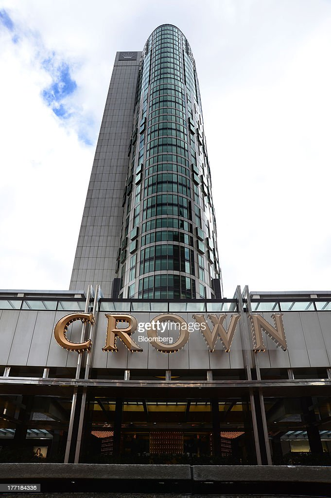 Signage for Crown Ltd. is displayed above the entrance to the Crown Towers hotel, part of the Crown Melbourne casino and entertainment complex, in Melbourne, Australia, on Wednesday, Aug. 21, 2013. Crown Ltd., the gaming company controlled by billionaire James Packer, is scheduled to announce full-year results on Aug. 23. Photographer: Carla Gottgens/Bloomberg via Getty Images