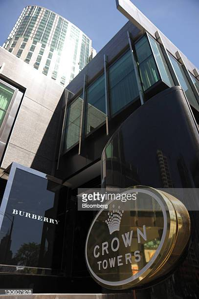 Signage for Crown Ltd's Crown Towers hotel is displayed alongside the logo for Burberry Group Plc at the entrance to the Crown Casino and...