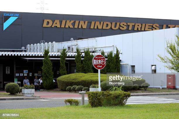 Signage for Daikin Industries Ltd is displayed atop a building at the company's Shiga plant in Kusatsu Shiga Japan on Thursday Aug 10 2017 Japan is...