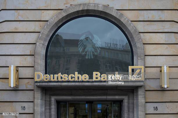 Signage for Deutsche Bank AG sits above a bank branch in Frankfurt Germany on Thursday July 20 2017 Frankfurt has emerged as a winner of the Brexit...