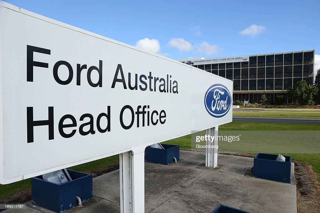 Signage for Ford Motor Co.'s Australia head office stands outside the building in Melbourne, Australia, on Thursday, May 23, 2013. Ford will stop making cars in Australia, nine decades after founder Henry Ford first began building Model Ts in the country, as a surge in the currency undermines the local industry's ability to compete with imports. Photographer: Carla Gottgens/Bloomberg via Getty Images