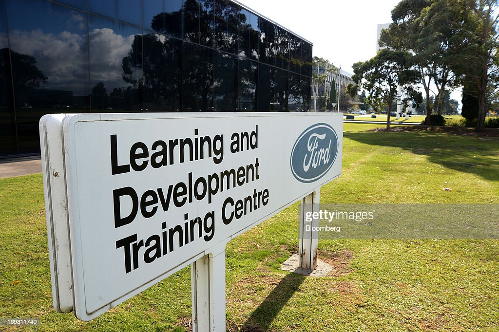 Signage for Ford Motor Co.'s Learning and Development Training Centre stands outside the facility in Melbourne, Australia, on Thursday, May 23, 2013. Ford will stop making cars in Australia, nine decades after founder Henry Ford first began building Model Ts in the country, as a surge in the currency undermines the local industry's ability to compete with imports. Photographer: Carla Gottgens/Bloomberg via Getty Images