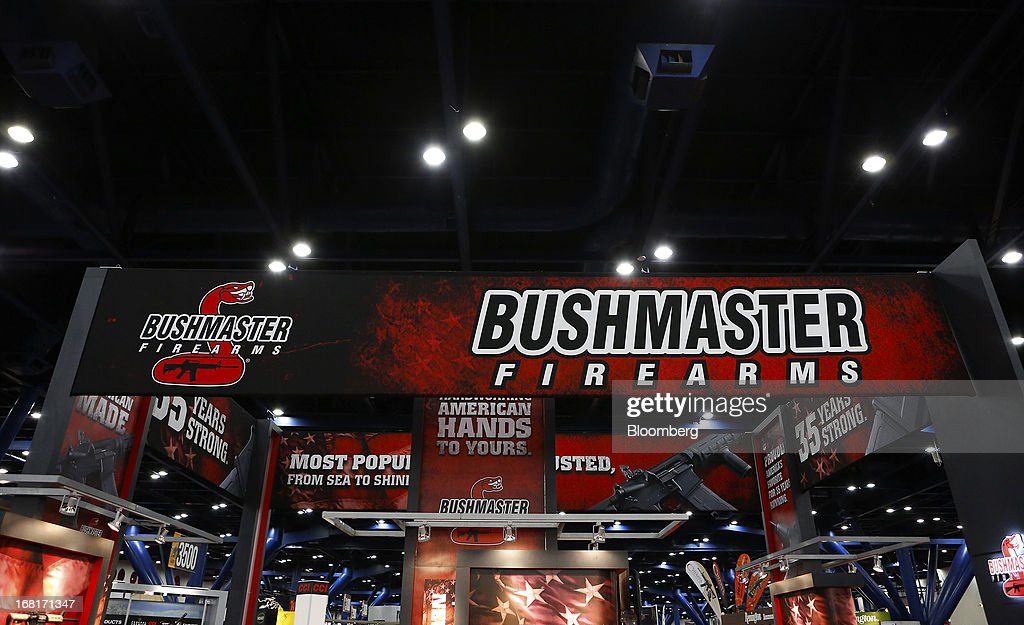 Signage for Freedom Group Inc.'s Bushmaster brand guns is displayed at their booth at the 2013 National Rifle Association (NRA) Annual Meetings & Exhibits at the George R. Brown Convention Center in Houston, Texas, U.S., on Saturday, May 4, 2013. After the U.S. Senate defeated a proposed expansion of background checks on gun purchases, the NRA's annual conference has a celebratory atmosphere. Yet as the festivities began, gun-control advocates swarmed town halls, organizing petitions and buying local ads to pressure senators from Alaska to New Hampshire to reconsider the measure that failed by six votes on April 17. Photographer: Aaron M. Sprecher/Bloomberg via Getty Images