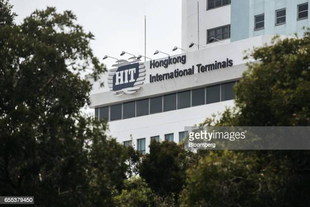 Signage for Hong Kong International Terminal a unit of CK Hutchison Holdings Ltd is displayed outside a building at the Kwai Tsing Container...
