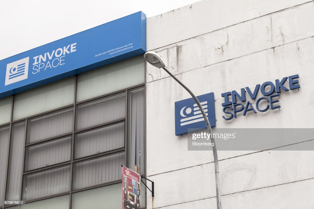 Signage for Invoke is displayed atop a building housing the company's office in Kuala Lumpur, Malaysia, on Tuesday, April 18, 2017. Invoke is a policy research shop with about 80 employees set up last October by Rafizi Ramli, vice president of the opposition Peoples Justice Party, or PKR. He calls the data operation his secret weapon to oust Prime Minister Najib Razak in an election expected this year. Photographer: Charles Pertwee/Bloomberg via Getty Images