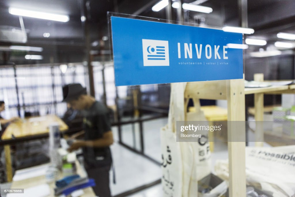 Signage for Invoke is seen pasted to a glass window at the company's office in Kuala Lumpur, Malaysia, on Tuesday, April 18, 2017. Invoke is a policy research shop with about 80 employees set up last October by Rafizi Ramli, vice president of the opposition Peoples Justice Party, or PKR. He calls the data operation his secret weapon to oust Prime Minister Najib Razak in an election expected this year. Photographer: Charles Pertwee/Bloomberg via Getty Images