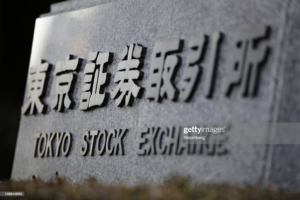 Signage for Japan Exchange Group Inc.'s Tokyo Stock Exchange (TSE) is seen outside the bourse on the first trading day of the year in Tokyo, Japan, on Friday, Jan. 4, 2013. Japan Exchange, created by the merger of Japan's two biggest bourses, fell in its trading debut on the Tokyo Stock Exchange. Photographer: Kiyoshi Ota/Bloomberg via Getty Images