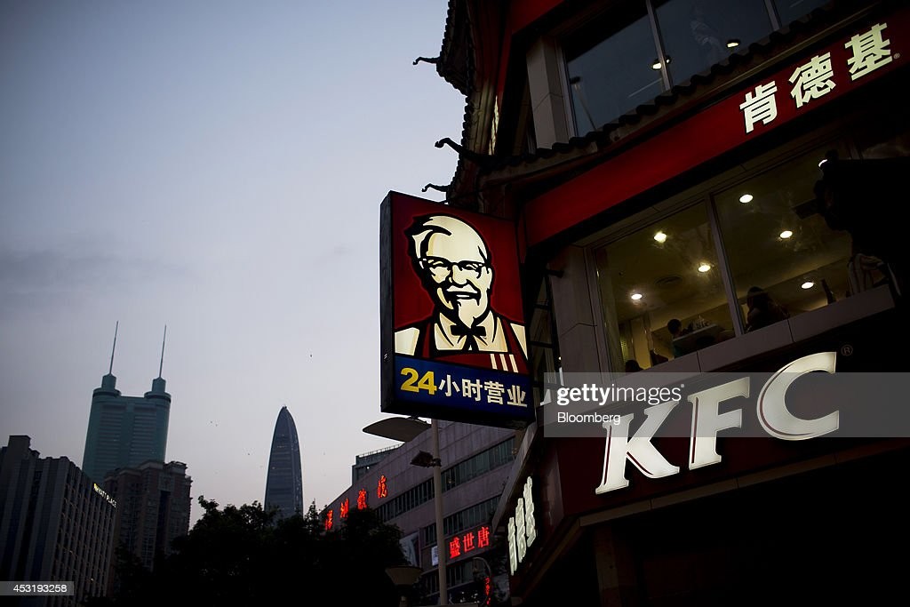 Signage for KFC, operated by Yum! Brands Inc., hangs outside a restaurant in the pedestrianized Dongmen area of Shenzhen, China, on Monday, Aug. 4, 2014. Yum, owner of KFC and Pizza Hut, said its China team is trying to regain customers after a supply chain scare has recently hurt results. Photographer: Brent Lewin/Bloomberg via Getty Images