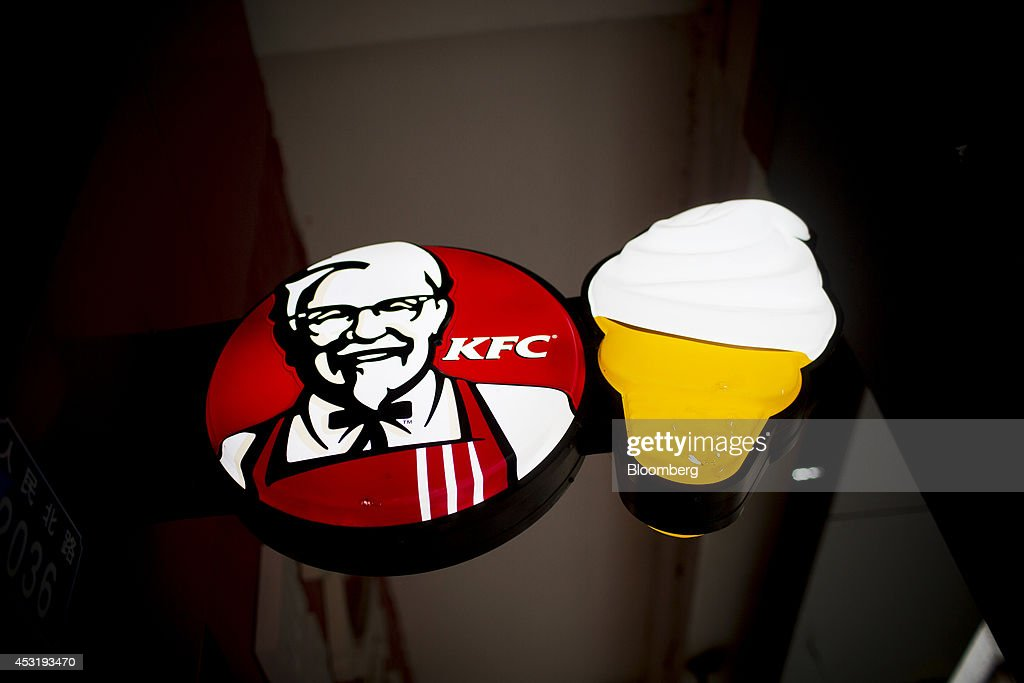 Signage for KFC, operated by Yum! Brands Inc., hangs outside a restaurant in the Luohu district of Shenzhen, China, on Monday, Aug. 4, 2014. Yum, owner of KFC and Pizza Hut, said its China team is trying to regain customers after a supply chain scare has recently hurt results. Photographer: Brent Lewin/Bloomberg via Getty Images