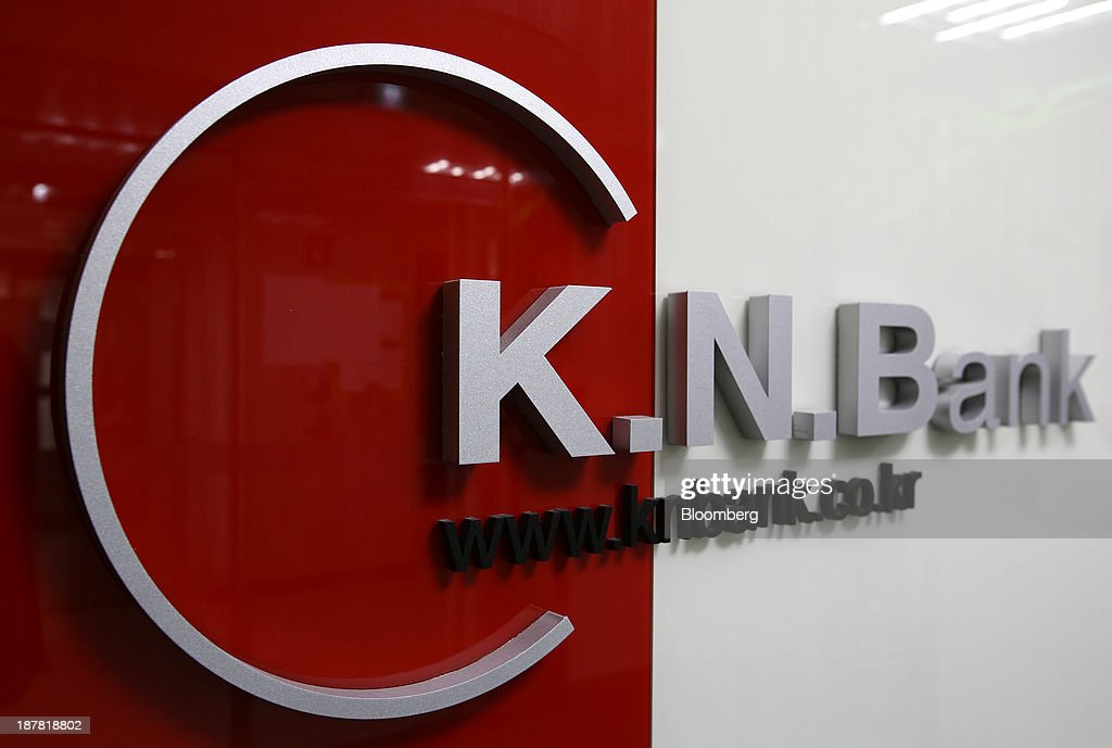 Signage for Kyongnam Bank, a unit of Woori Finance Holdings Co., is displayed at one of the bank's branches in Seoul, South Korea, on Tuesday, Nov. 12, 2013. Woori Finance Holdings is scheduled to report third-quarter results on Nov. 14. Photographer: SeongJoon Cho/Bloomberg via Getty Images
