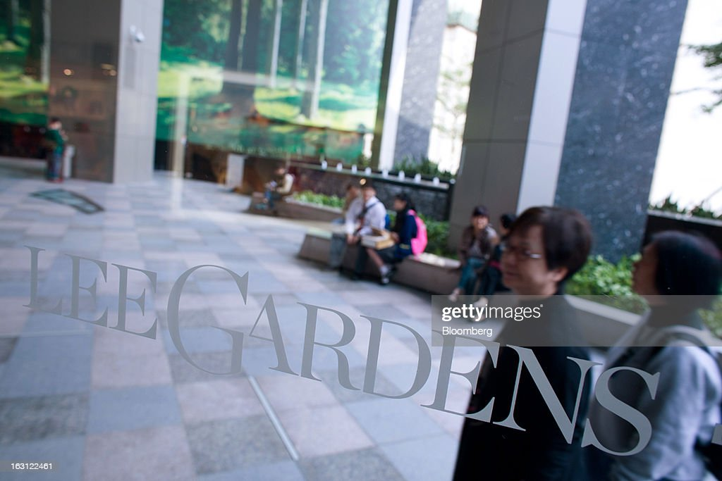 Signage for Lee Gardens is displayed on a window at Hysan Development Co.'s Hysan Place mall in the Causeway Bay district of Hong Kong, China, on Monday, March 4, 2013. Hysan is scheduled to release earnings on March 6. Photographer: Lam Yik Fei/Bloomberg via Getty Images
