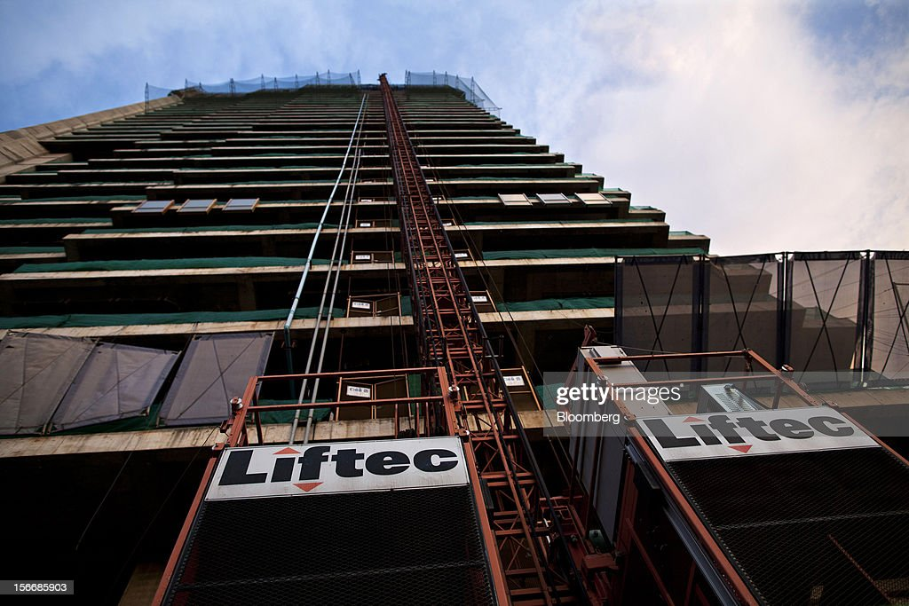Signage for Liftec Co. is displayed at the Gold Tower 42 project, developed by Yon Woo Cambodia Co., as it stands unfinished in Phnom Penh, Cambodia, on Sunday, Nov. 18, 2012. U.S. President Barack Obama arrives in Phnom Penh later today to join the Association of Southeast Asian Nations (Asean) East Asia Summit, which also includes leaders from Japan, South Korea, India, Russia, Australia and New Zealand. Photographer: Will Baxter/Bloomberg via Getty Images