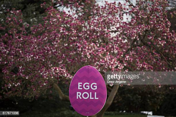 Signage for Monday's Easter Egg Roll is set up on the South Lawn of the White House March 26 2016 in Washington DC President Obama played golf at...