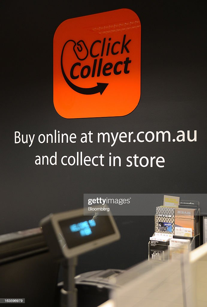 Signage for Myer Holdings Ltd.'s online shopping services is displayed behind a counter for customer collections at the company's Melbourne City store in Melbourne, Australia, on Wednesday, March 13, 2013. Myer is scheduled to release company results on March 14. Photographer: Carla Gottgens/Bloomberg via Getty Images