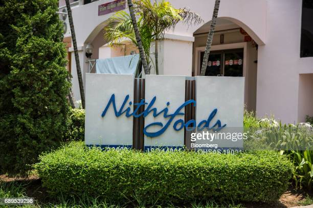 Signage for Nithi Foods Co is displayed at the entrance to the company's factory in the San Pa Tong district of Chiang Mai Thailand on Tuesday May 23...